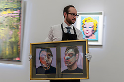 "© Licensed to London News Pictures. 08/04/2016. London, UK. A Sotheby's technician carries Francis Bacon's ""Two Studies for a Self-Portrait"", 1970, est. $22-30million at Sotheby's auction preview, at their New Bond Street gallery, of works to be in the upcoming New York Impressionist, modern and contemporary art sale. Photo credit : Stephen Chung/LNP"