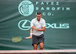 April 13, 2018 - Houston, TX, U.S. - HOUSTON, TX - APRIL 13:  Nick Kyrgios of Australia holds his arm in pain in the match against Ivo Karlovic of Croatia during the Quarterfinal round of the Men's Clay Court Championship on April 13, 2018 at River Oaks Country Club in Houston, Texas.  (Photo by Leslie Plaza Johnson/Icon Sportswire) (Credit Image: © Leslie Plaza Johnson/Icon SMI via ZUMA Press)