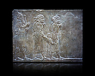 Stone relief sculptured panel of prisoners from the campaign of Elam. From the palace of Ashurnasirpal II  room VI/T1, Nineveh, circa 645 BC. inv 19908  Louvre Museum , Paris .<br /> <br /> If you prefer to buy from our ALAMY PHOTO LIBRARY  Collection visit : https://www.alamy.com/portfolio/paul-williams-funkystock/ancient-assyria-antiquities.html  Refine search by adding background colour, place, subject, museum etc into the LOWER SEARCH WITHIN GALLERY box to <br /> <br /> Visit our ANCIENT ASSYRIAN PHOTO COLLECTIONS for more photos to download or buy as wall art prints https://funkystock.photoshelter.com/gallery-collection/Ancient-Assyrian-Art-Artefacts-Antiquities-Historic-Sites-Pictures-Images-of/C0000cjRqQyJjLag