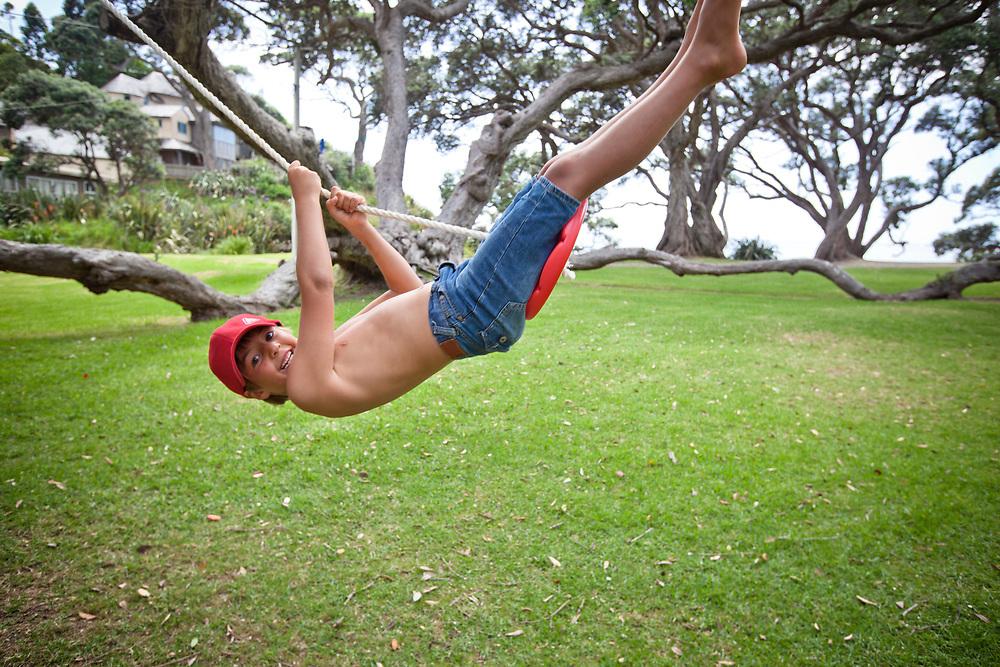 8 yr old boy on tree swing