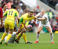 Photo by Andrew Tobin/Tobinators Ltd. Heather Fisher (R) gets to grips with an Australian player from the IRB London Rugby 7s tournament held at Twickenham Stadium, London on 12th May 2013. New Zealand won the tournament beating Australia in the final, and also won the overall 2012/13 series.