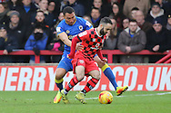 AFC Wimbledon defender Darius Charles (32) tackling Walsall midfielder Erhun Oztumer (10) during the EFL Sky Bet League 1 match between AFC Wimbledon and Walsall at the Cherry Red Records Stadium, Kingston, England on 25 February 2017. Photo by Matthew Redman.