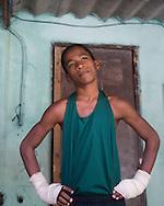 Young boxer warming up under the bleachers for a match, Havana, Cuba