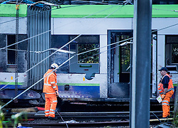 © Licensed to London News Pictures. 11/11/2016. Croydon, UK. The damaged tram can be seen for the first time after it was moved into an upright position. Investigations are continuing into a tram crash that claimed seven lives and injured 50. The driver has been questioned by police before being released on bail. Photo credit: Peter Macdiarmid/LNP