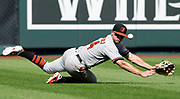 Baltimore Orioles left fielder John Andreoli is unable to catch a short fly ball from Kansas City Royals' Alex Gordon in the eighth inning of a baseball game at Kauffman Stadium in Kansas City, Mo., Sunday, Sept. 2, 2018. Gordon had an RBI double on the play. The Royals defeated the Orioles 9-1.  (AP Photo/Colin E. Braley)