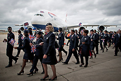 © London News Pictures. 04/07/2013 . London, UK.  British Airways staff walk in front of the new British Airways Boeing A380 superjumbo as it arrives at Heathrow Airport. It was the first time British Airlines have taken delivery of the new plane, making British Airways the first European airline to operate both the 787 and A380. Photo credit : Ben Cawthra/LNP