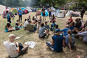 Extinction Rebellion briefing as campaigners use Waterloo Millennium Green as a temporary campsite during a week of climate change actions across the country on the 17th July 2019 in London in the United Kingdom. Extinction Rebellion are a socio-political movement using civil disobedience and nonviolent resistance to protest against climate breakdown, biodiversity loss, and the risk of social and ecological collapse.