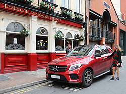 Juan Mata returns to his car to receieve a £60 parking ticket after attending Ander Herrera's Birthday Lunch at Tapeo & Wine Restaurant in Manchester