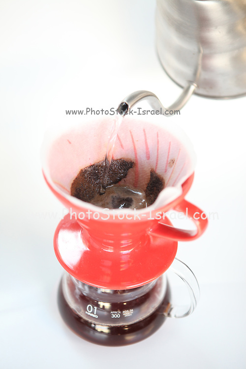Filtering Coffee through paper filter