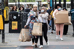© Licensed to London News Pictures. 15/06/2020. Manchester, UK. Primark customers on Market Street . High street shops reopen in Manchester City Centre for the first time since measures forced non-essential retailers to close , in order to limit the spread of the Coronavirus . Photo credit: Joel Goodman/LNP