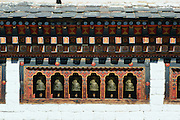 Prayer wheels at Tashichho Dzong in Thimpu, Bhutan