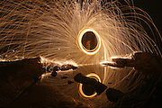 RIZHAO, CHINA - JUNE 24: (CHINA OUT) <br /> <br /> Fire Work Views <br /> <br /> A tourist plays with fireworks near the sea on June 24, 2014 in Rizhao, Shandong province of China.<br /> ©Exclusivepix