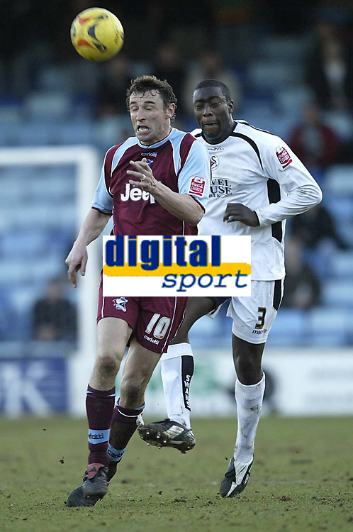 Photo: Aidan Ellis.<br /> Scunthorpe United v Swansea City. Coca Cola League 1. 18/02/2006.<br /> Scunthorpe's Steve Torpey and Swansea's Kevin Austin battle for the ball