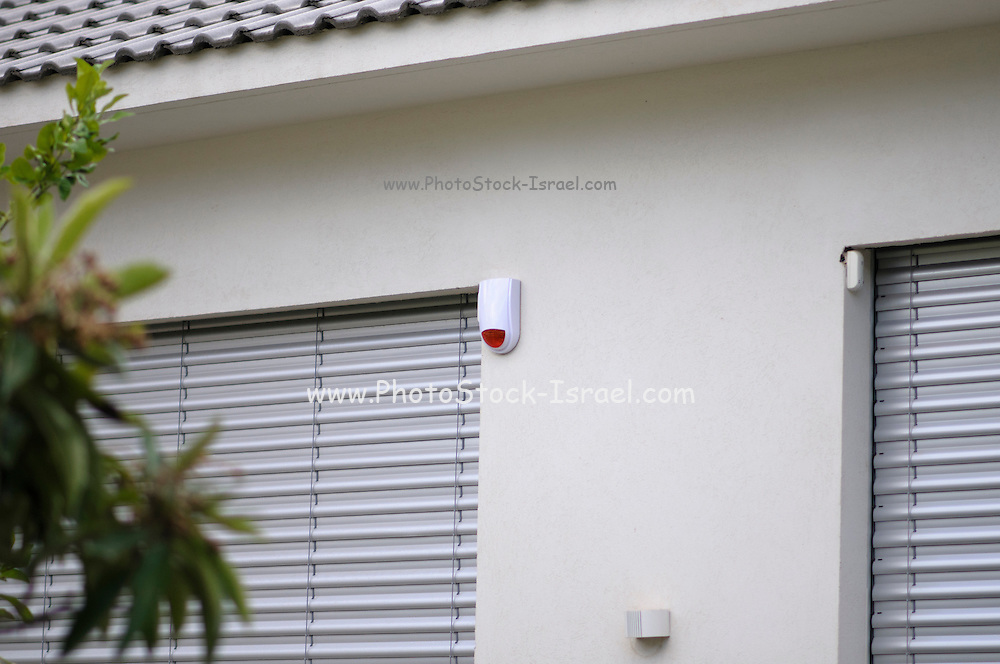 outdoor motion detector for a home security system