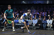Simon Rosner of Germany (in the white shirt) with a shot against Charles Sharpes of England (in the Green shirt). Canary Wharf Squash Classic 2016 , day two at the East Wintergarden in Canary Wharf , London on Tuesday 8th March 2016.<br /> pic by John Patrick Fletcher, Andrew Orchard sports photography.