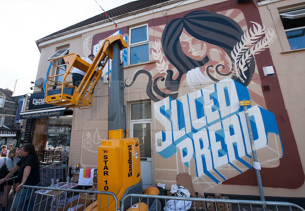 © Licensed to London News Pictures. 25/07/2015. Bristol, UK.  'Sliced Bread' piece by Inkie at Upfest 2015, Europe's largest, free, street art & graffiti festival, attracting over 250 artists painting 28 venues throughout Bedminster & Southville, Bristol.  Talented artists travel from 25 countries and across the UK to paint live on 30,000sqft of surfaces in front of 25,000 visitors. There is also an affordable art sale, music stages and art workshops.  Photo credit : Simon Chapman/LNP