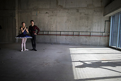 © Licensed to London News Pictures. 21/03/2017. London, UK. Dancers stand in The Central School of Ballet's newly announced building in central London. The dancers wear costumes from their forthcoming nationwide Ballet Central tour 2017 against the backdrop of the unfinished interior of the new premises. Photo credit: Peter Macdiarmid/LNP
