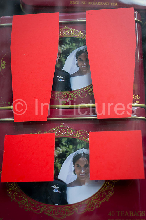 British royal family merchanidise and tourism souvenir tea bags which show the faces of Meghan Markle and Prince Harry, the Duke and Duchess of Sussex at their 2018 wedding, behind two exclamation marks in the window of trinket shop in the West End, on 15th January 2020, in London, England.