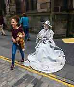 Street performer woman in white. Edinburgh, capital of Scotland, UK, Europe.