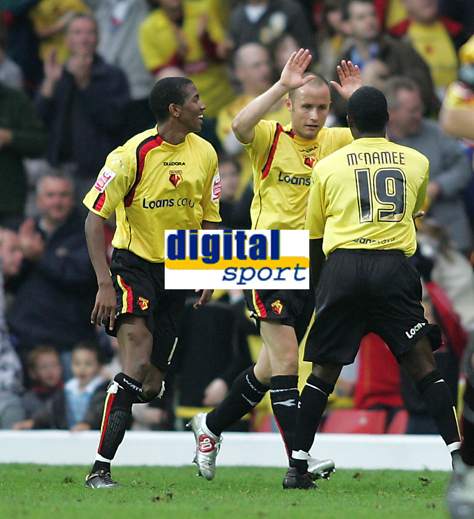 Photo: Lee Earle.<br /> Watford v Wolverhampton Wanderers. Coca Cola Championship. 29/10/2005. Anthony McNamee congratulates Watford's third goal scorer Paul Devlin.