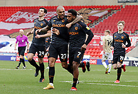 Hull City's Mallik Wilks (right) celebrates with team-mate Josh Magennis after scoring the opening goal <br /> <br /> Photographer Rich Linley/CameraSport<br /> <br /> The EFL Sky Bet League One - Doncaster Rovers v Hull City - Saturday 20th February 2021 - Keepmoat Stadium - Doncaster<br /> <br /> World Copyright © 2021 CameraSport. All rights reserved. 43 Linden Ave. Countesthorpe. Leicester. England. LE8 5PG - Tel: +44 (0) 116 277 4147 - admin@camerasport.com - www.camerasport.com