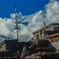 The Annapurna massif towers above a Tibetan Buddhis temple (gompa) in remote remote Manang village, Nepal.