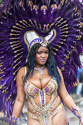 © Licensed to London News Pictures. 31/08/2015. London, UK. A dancer braves the heavy rain to take part in Notting Hill Carnival, Europe's biggest Caribbean festival. Photo credit : Stephen Chung/LNP