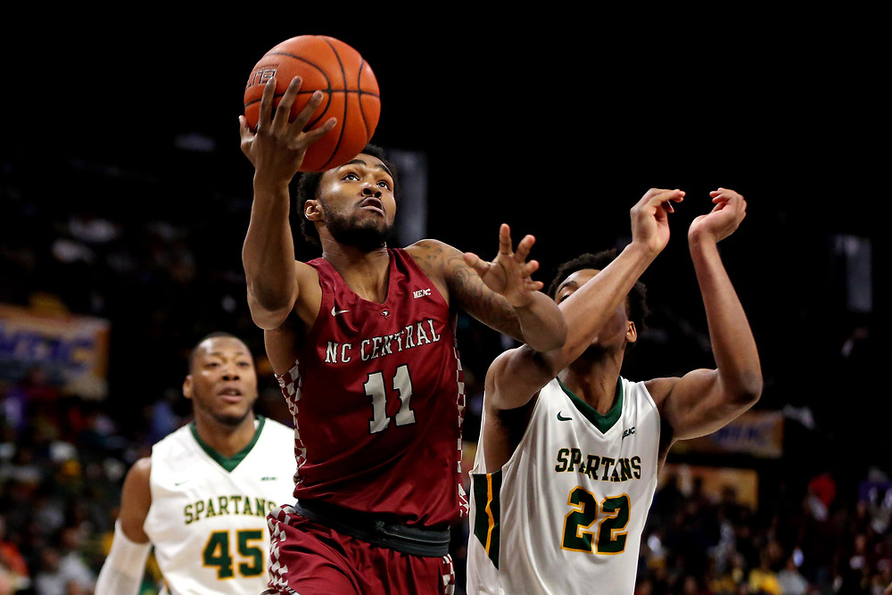 Mar 16, 2019; Norfolk, VA, USA; North Carolina Central Eagles guard Randy Miller Jr. (11) shoots the ball against Norfolk State Spartans forward Alex Long (22) during the first half in the MEAC Tournament Final at The Scope. Mandatory Credit: Peter Casey-USA TODAY Sports