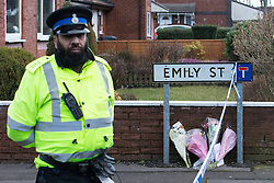 © Licensed to London News Pictures . 11/02/2014 . Blackburn , UK . Flowers and tributes left at the scene . Police and forensic examiners on Emily Street in Blackburn at the scene where an eleven month old baby girl was mauled to death late last night (10th February 2014) . Photo credit : Joel Goodman/LNP