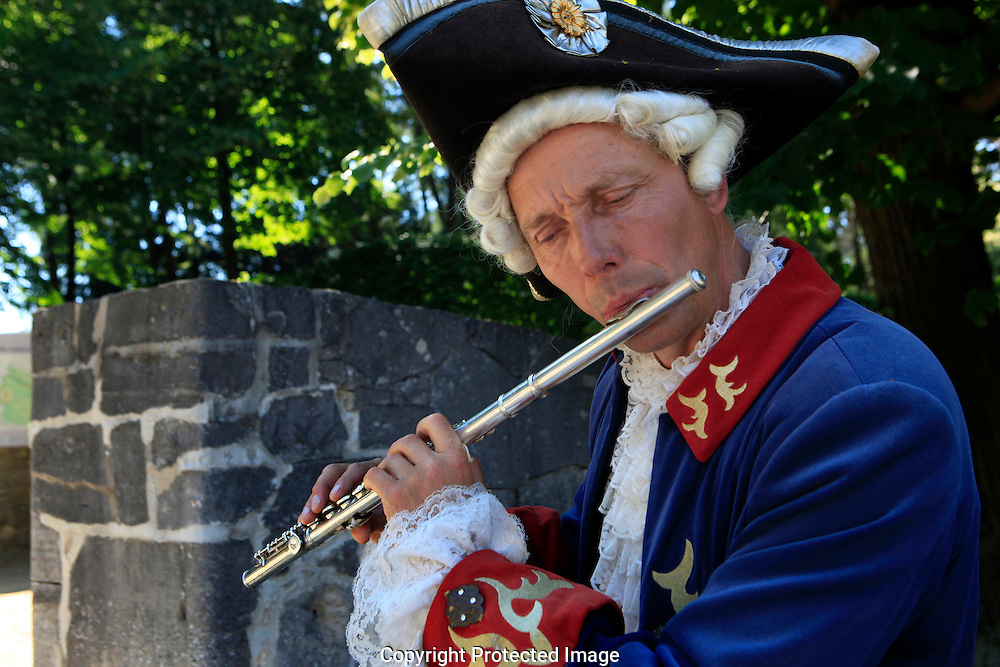 A flutist at the gate of Charlottenburg Palace, Germany<br /> <br /> Photo by Dennis Brack