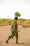 Nyangatom tribesman. Most adult males carry rifles. Omo Valley, Ethiopia