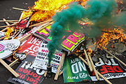 A bonfire made of placards and sticks in Parliament Square. The anti-austerity march, the People's Assembly saw tens of thousands marching and protestin in the streets of London against the newly elected conservative government.