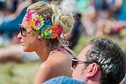 Fans enjoy the sunshine as Laura Mvula plays the Obelisk Stage - The 2016 Latitude Festival, Henham Park, Suffolk.