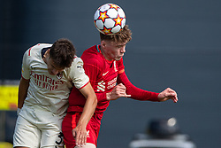 LIVERPOOL, ENGLAND - Wednesday, September 15, 2021: Liverpool's Conor Bradley (R) challenges for a header with AC Milan's Milos Kerkez during the UEFA Youth League Group B Matchday 1 game between Liverpool FC Under19's and AC Milan Under 19's at the Liverpool Academy. Liverpool won 1-0. (Pic by David Rawcliffe/Propaganda)