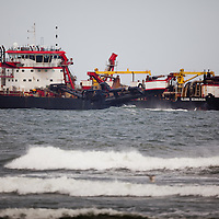 The dredging vessel Glenn Edwards arrives in Loch Arbour to pump sand onto the beach that is part of a $38 million beach nourishment project that affects a stretch of shoreline from southern Deal to Loch Arbour in Monmouth County New Jersey. The project including pumping in of sand as a method to protect the shoreline as well as notching of jetties to prevent sand from eroding too quickly has begun.