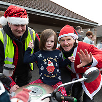 Eimear Conway from Ennis with Johnny Murphy and Donie Shannon from West Clare Motorcycle club