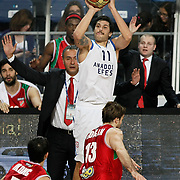 Anadolu Efes's Cenk Akyol (B) during their Turkish Basketball League match Anadolu Efes between Pinar Karsiyaka at Arena in Istanbul, Turkey, Saturday, November 26, 2011. Photo by TURKPIX