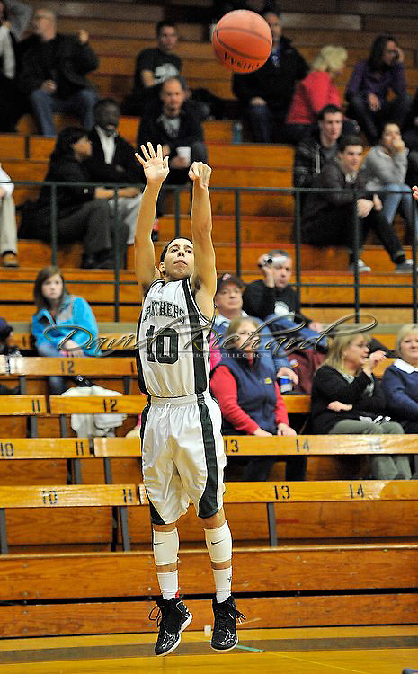 Oberlin at Elyria Catholic boys JV basketball on January 15, 2013. Images © David Richard and may not be copied, posted, published or printed without permission.