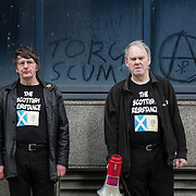 Sean Clerkin (R) of the Scottish Resistance at a demo in Cadogan Street, Glasgow. With fellow member James Scott (L).  Picture Robert Perry 29th Jan 2016<br /> <br /> Must credit photo to Robert Perry<br /> FEE PAYABLE FOR REPRO USE<br /> FEE PAYABLE FOR ALL INTERNET USE<br /> www.robertperry.co.uk<br /> NB -This image is not to be distributed without the prior consent of the copyright holder.<br /> in using this image you agree to abide by terms and conditions as stated in this caption.<br /> All monies payable to Robert Perry<br /> <br /> (PLEASE DO NOT REMOVE THIS CAPTION)<br /> This image is intended for Editorial use (e.g. news). Any commercial or promotional use requires additional clearance. <br /> Copyright 2014 All rights protected.<br /> first use only<br /> contact details<br /> Robert Perry     <br /> 07702 631 477<br /> robertperryphotos@gmail.com<br /> no internet usage without prior consent.         <br /> Robert Perry reserves the right to pursue unauthorised use of this image . If you violate my intellectual property you may be liable for  damages, loss of income, and profits you derive from the use of this image.