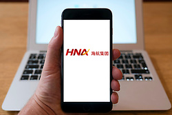 HNA chinese conglomerate group logo on website on smart phone screen.