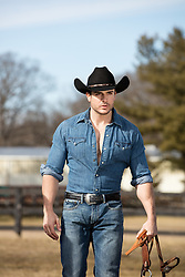 hot cowboy with reins on a ranch