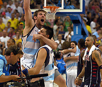 27/08/04 - ATHENS  - GREECE -  - BASKETBALL SEMIFINAL MATCH   - Indoor Olympic Stadium - <br />ARGENTINA win (89) over USA United States of America (81) <br />Argentine celebration after win the match.<br />ANDRES NOCIONI with GABRIEL FERNANDEZ.<br />In the back USA N*7 BOOZER CARLOS.<br />© Gabriel Piko / Argenpress.com / Piko-Press