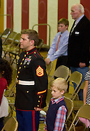 """Westfall, Pennsylvania - Delaware Valley  Elementary School students and veterans stand while """"Taps"""" is played  during an assembly in the gymnasium where veterans were honored on Nov. 8, 2013."""