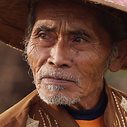 A portrait of Mr. Karto Prawiro, a duck farmer, in Java, Indonesia