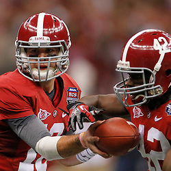 Jan 9, 2012; New Orleans, LA, USA; Alabama Crimson Tide quarterback A.J. McCarron hands the ball off to running back Eddie Lacy (42)during the first half of the 2012 BCS National Championship game at the Mercedes-Benz Superdome.  Mandatory Credit: Derick E. Hingle-US PRESSWIRE