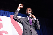 """BIRMINGHAM, AL – DECEMBER 11, 2017: On the eve of the Special General Election for Senate, Birmingham Mayor Randall Woodfin speaks to the crowd and endorses democratic candidate Doug Jones in a """"get out the vote"""" rally.  CREDIT: Bob Miller for The New York Times"""