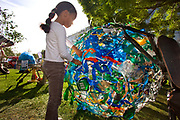 Child building world globe from waste materials in the enviromental zone,Potter's Field, along the southbank of the Thames. September 2008