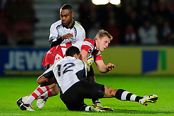 Gloucester Outside Centre (#13) Drew Locke is tackled by Fiji Inside Centre (#12) Josh Matavesi during the first half of the match - Photo mandatory by-line: Rogan Thomson/JMP - Tel: Mobile: 07966 386802 13/11/2012 - SPORT - RUGBY - Kingsholm Stadium - Gloucester. Gloucester Rugby v Fiji - International Friendly