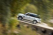 An offroad vehicle drives through the mountains in Basque countryside, near San Sebastian, Spain