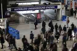 © Licensed to London News Pictures. 09/01/2017. London, UK. Commuters go past a closed entrance of Waterloo Tube Station as London Underground services are severely disrupted due to RMT and TSSA unions' 24-hour strike action in a dispute over jobs cuts and closed ticket offices on January 9, 2017. Photo credit: Tolga Akmen/LNP